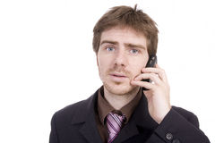 Young business man holding a cellphone Royalty Free Stock Images
