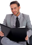 Young business man holding a clip board Royalty Free Stock Photos