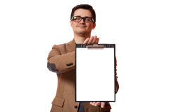 Young business man holding a clip board over white background.  Royalty Free Stock Photography