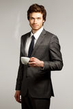 Young Business Man Holding a Cup Royalty Free Stock Photography