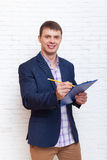 Young Business Man Holding Folder Document Writing,  Businessman Standing Over Wall Royalty Free Stock Images