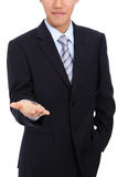 Young business man holding hand presenting Royalty Free Stock Photos