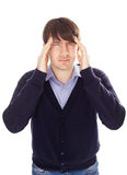 Young business man holding head in pain Stock Photo