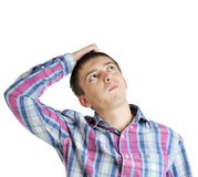 Young business man holding his head and thinking Stock Photography