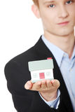 Young business man holding house model Stock Images