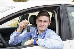 Young business man holding keys of his car Stock Photo