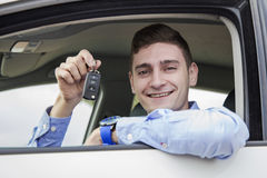 Young business man holding keys of his car Stock Images