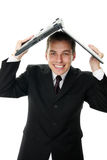 Young business man holding a laptop computer Stock Photos