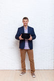 Young Business Man Holding Laptop Tablet Computer With Empty Copy Space Stock Photo