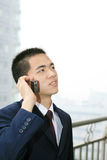 Young business man holding mobile phone Stock Photo