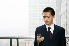 Young business man holding mobile phone Royalty Free Stock Images