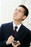 Young business man holding mobile phone Royalty Free Stock Photo