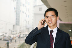 Young business man holding mobile phone Stock Images