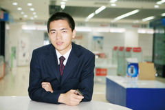 Young business man holding mobile phone Royalty Free Stock Photography