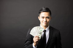 Young business man holding money Royalty Free Stock Image
