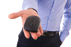 Businessman holding mouse. Royalty Free Stock Photography