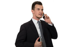 Young business man holding phone Royalty Free Stock Photos
