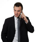 Young business man holding phone Stock Images