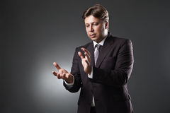 Young business man holding something on his hand Stock Image
