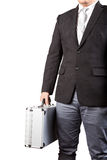 Young business man holding stong metal suitcase isolated white b Royalty Free Stock Photos