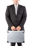 Young business man holding strong metal briefcase in hand isolat Stock Photography