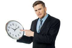 Young business man holding wall clock Stock Photography