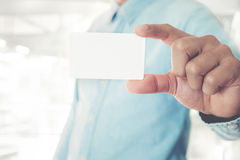 Young business man holding white business card Stock Image