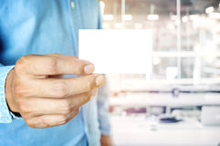 Young business man holding white business card on stock photos