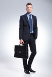 Young business man holds his suitcase Royalty Free Stock Image