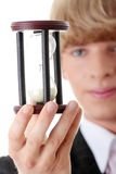 Young business man with hourglass Royalty Free Stock Photography