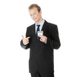 Young business man with house model Royalty Free Stock Images