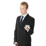 Young business man with house model Stock Photography