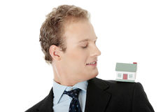 Young business man with house model Stock Images