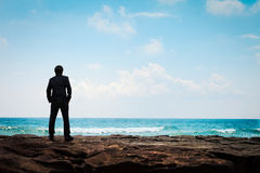 Young Business Man In Suit Face To The Sea Stock Images
