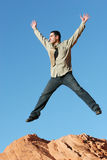 Young business man jumping. Handsome young business man jumping - blue sky background Stock Photos