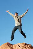 Young business man jumping. Handsome young business man jumping - blue sky background Stock Images