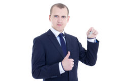 Young business man with key in hand thumbs up isolated on white Stock Photos