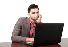 Young business man with a laptop Royalty Free Stock Image