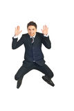 Young business man leaping. And showing palms isolated on white background Royalty Free Stock Photography