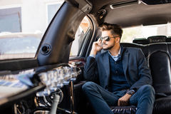 Young business man in limo Royalty Free Stock Image