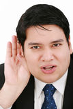 Young business man listening Royalty Free Stock Image