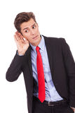 Young business man, listening Royalty Free Stock Images