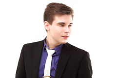 Young business man looking away and smiling Royalty Free Stock Image