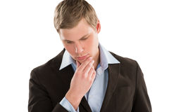 Young business man looking away and thinking Royalty Free Stock Photography