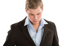 Young business man looking away and thinking Stock Photography