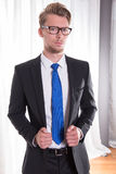 Young business man looking critical Royalty Free Stock Images
