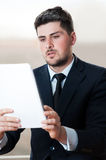 Young business man looking at flip chart Royalty Free Stock Images