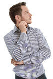 Young business man looking pensive away. Royalty Free Stock Photos
