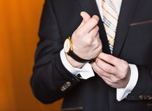 Young business man  looking at watch over white Stock Images