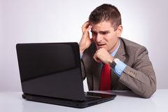 Young business man looks disappointed at laptop Stock Photography
